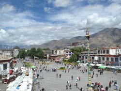View of the Borkhar Square and Himalayan Mountains seen from the top of the Jokhang temple