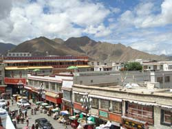 View of the market and Himalayan Mountains seen from the Jokhang temple