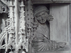 Person peering out of a window under the pulpit of St Stephans Cathedral in Vienna