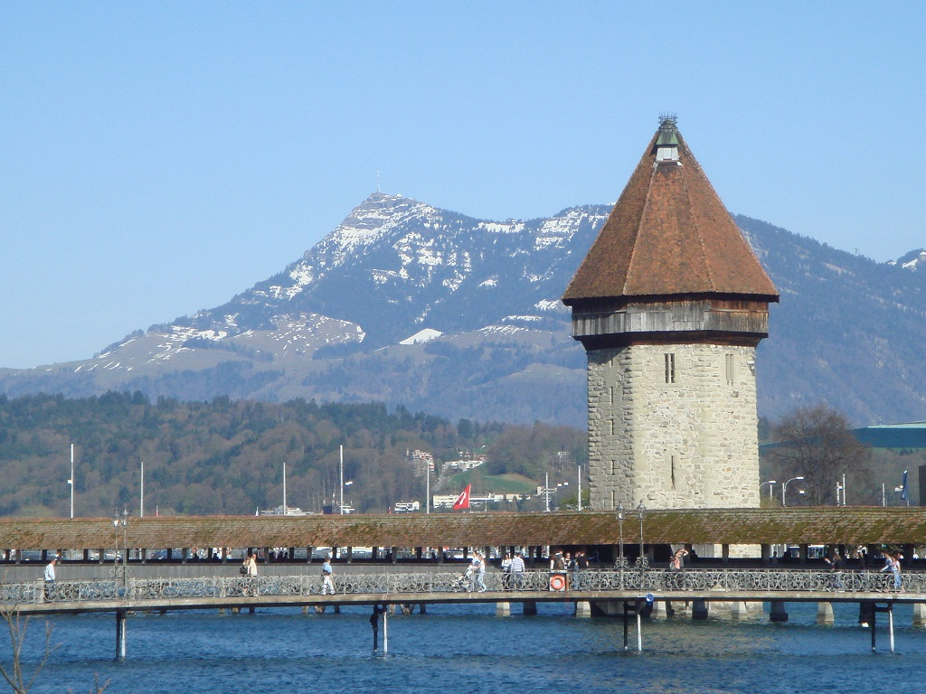 The Water Tower adjacent to the Chapel Bridge (Kappelbrucke) in Lucerne with Rigi in the background