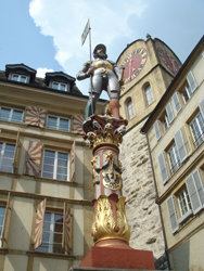 Statue above a fountain in the old town of Neuchâtel