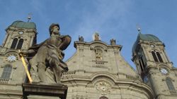 Statue of St Paul in front of the two towers of the Benedictine Einsiedeln Monastry