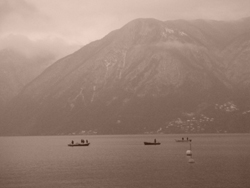 Boats on the misty Lake Lugano, Ticino, Switzerland
