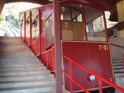 The bright red funicular heading up to the summit of Monte Bre from Suvigliana in Lugano, Ticino