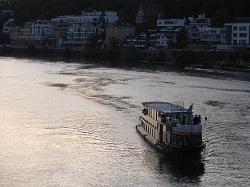 Heidelberg - a ship sailing the river at sunset